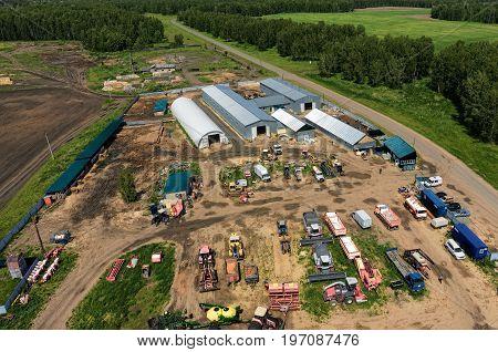 Verhovina, Russia - June 14, 2017: Aerial view onto modern machine yard of agricultural firm. Sverdlovsk region