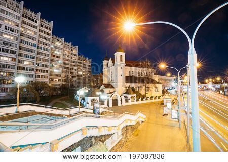 Minsk, Belarus - April 3, 2017: Evening Night View Of Cathedral of the Holy Apostles Sts Peter and Paul On Illuminated Nemiga Street. Temple of the Belarusian Exarchate of the Russian Orthodox Church