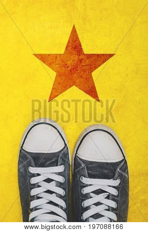 Young activist standing on the road with star shape imprint - youth activism and political action concept