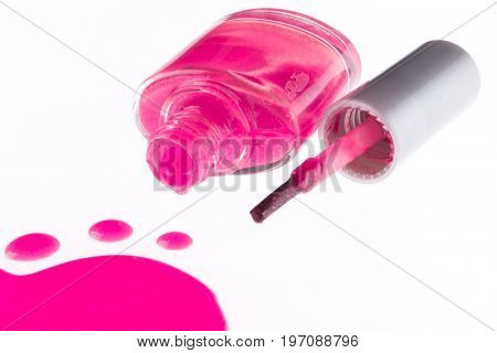 spilled pink nail polish isolated on white background