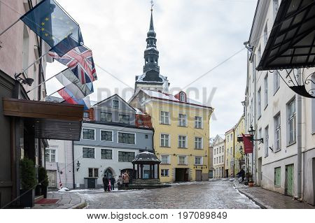 TALLINN ESTONIA - FEBRUARY 23 2016: Street of Old Town in Tallinn Estonia. Old Town is listed in the UNESCO World Heritage List