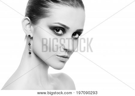 professional luxury female makeup on white background with copy space, monochrome