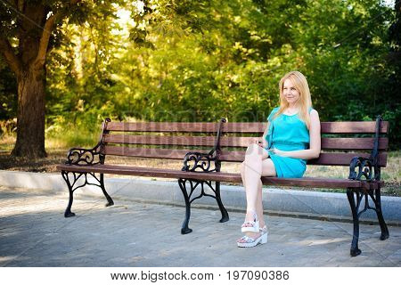 Young blonde girl walking in the park