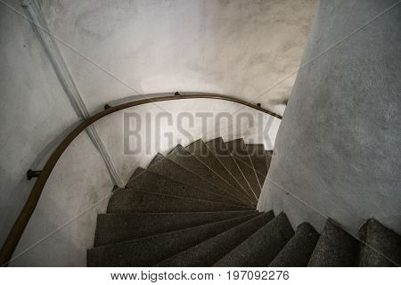Old spiral staircase shadow and light white