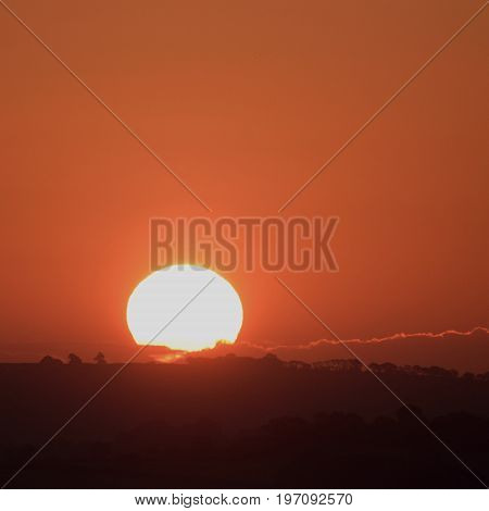 Sunrise on a misty morning over Axe Valley in East Devon England