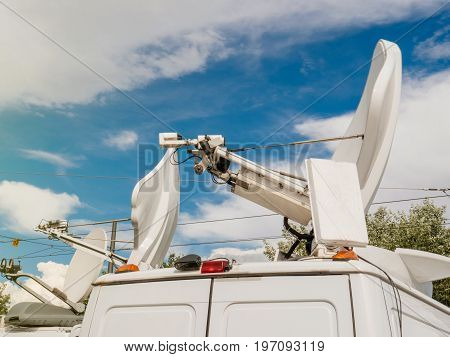 TV Media Television Trucks with multiple Satellite dish parabolic antennas and fiber optic cables preparing to report live a political sport or other news event