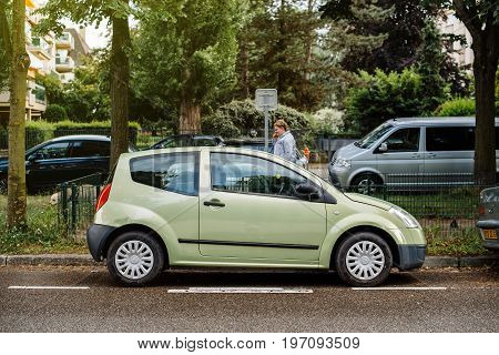 STRASBOURG FRANCE - MAY 30 2017: Small cute green Citroen C2 car parked on the French street