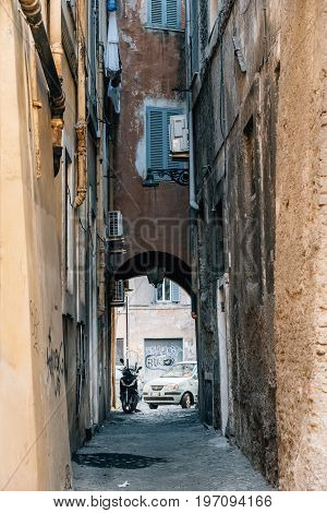 Rome Italy - August 20 2016: Picturesque pedestrian alley in historical centre of Rome a sunny summer day