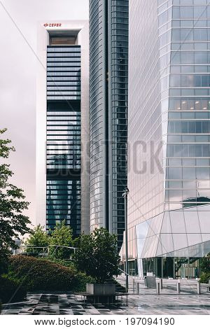 Madrid Spain - June 25 2017: View of skyscrapers in Cuatro Torres Business Area CTBA (Four Towers Business Area) a business district in Madrid against cloudy sky