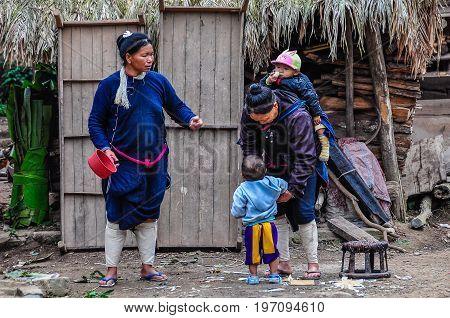 LUANG NAM THA, LAOS - DECEMBER 31, 2012: Laotian family in the village Luang Nam Tha Northern Laos