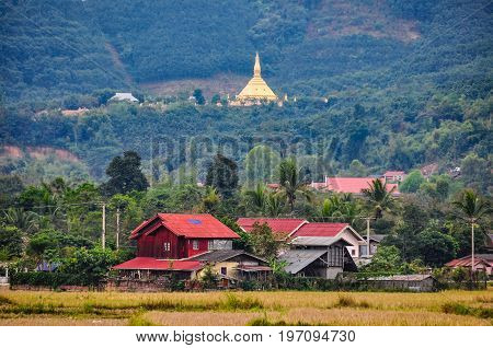 Village and golden stupa in the village Luang Nam Tha Northern Laos