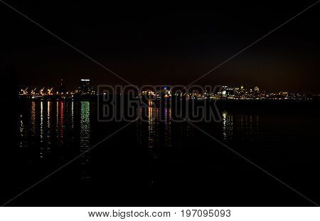 Baltimore, Usa - June 11, 2017: Cityscape Or Skyline Of City In Maryland At Night With Water