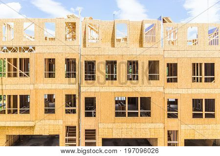 Fairfax, Usa - January 20, 2017: Construction Workers Building New Modern Townhouses With Garages On