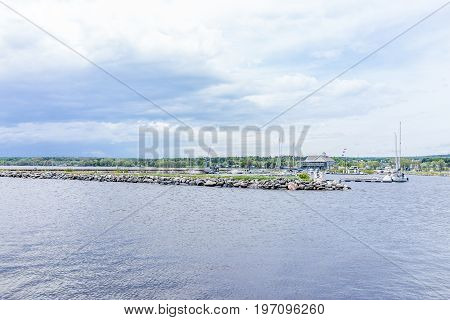 Portneuf, Canada - May 29, 2017: Boats On Harbor By Pier In Saint-laurent Or Saint Lawrence River