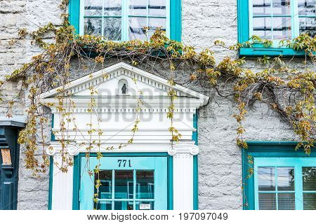 Quebec City, Canada - May 29, 2017: Blue Decorated Windows And Brick Stone Wall Architecture With Do