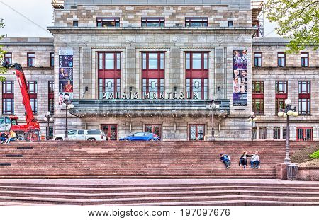 Quebec City, Canada - May 29, 2017: Palais Montcalm Colorful Theater With People Sitting On Red Stai