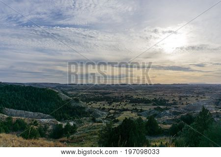 Dusk comes to the plains as seen from the bluffs in Theodore Roosevelt National Park