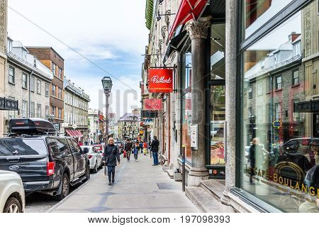 Quebec City, Canada - May 29, 2017: Old Town Street With People Walking By Restaurants And Paillard