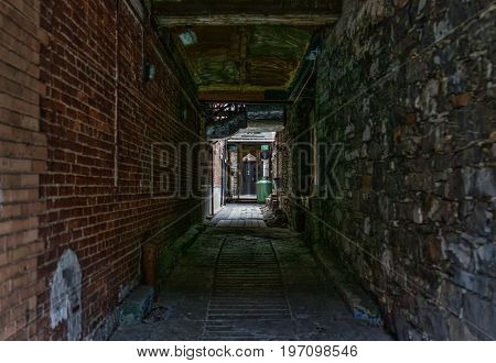 Quebec City, Canada - May 29, 2017: Old Town Street Narrow Dark Brick Alleyway With Path To Belle Gu