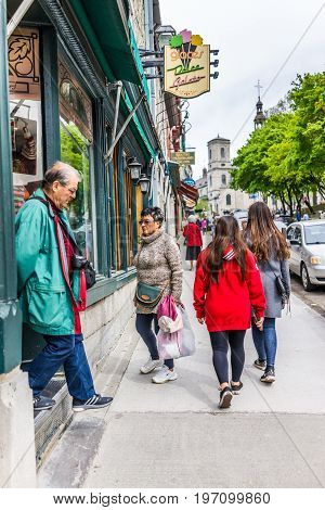 Quebec City, Canada - May 29, 2017: Old Town Street With Shops And Stores With Stone Wall Buildings