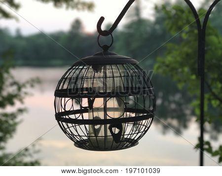 hummingbird feeder on the pond at dusk