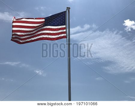Old Glory still waving proudly as the clouds roll by