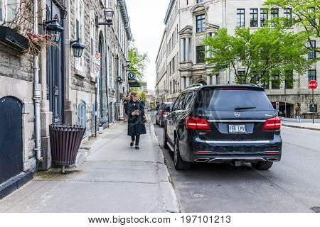 Quebec City, Canada - May 29, 2017: Old Town Street With Shops And Stores With People Walking By Car