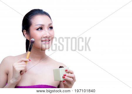 Closeup Portrait Of A Asian Woman Applying Dry Cosmetic Tonal Foundation On The Face Using Makeup Br