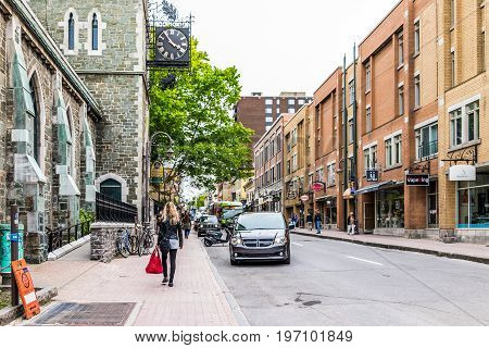 Quebec City, Canada - May 29, 2017: Saint Jean Baptiste Limoilou Area With Woman Walking By Claire M