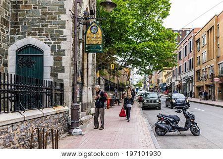 Quebec City, Canada - May 29, 2017: Saint Jean Baptiste Limoilou Area With People Walking By Claire