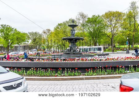 Quebec City, Canada - May 29, 2017: Tulip Flowers And Large Fountain In Summer By Roundabout With Ca