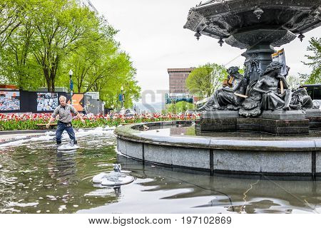 Quebec City, Canada - May 29, 2017: Man Cleaning Large Fountain From Protest In Summer By Roundabout