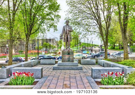 Quebec City, Canada - May 29, 2017: Statue Of Sir Lafontaine In Summer With Tulips Flowers By Parlia