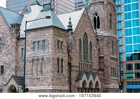 historic gothic style church in commercial business district of denver colorado