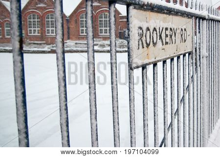 Snow at the rookery road with fence in Birmingham