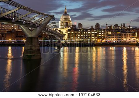 LONDON, ENGLAND - JUNE 18, 2016: Night photo of Millennium Bridge and  St. Paul Cathedral, London, Great Britain