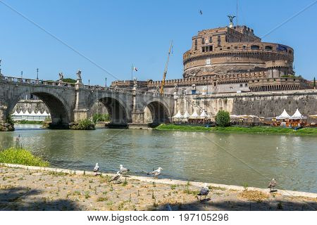 ROME, ITALY - JUNE 22, 2017: view of St. Angelo Bridge,  Tiber River and castle st. Angelo in city of Rome, Italy