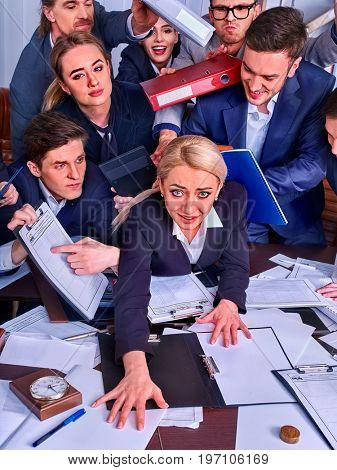 Business people office. Team people are unhappy with their leader. Intern manager does not cope with his duties. Crowd in stress. Top view. New employee on first working day.