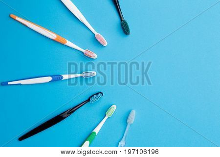Multicolored toothbrushes , place for inscription