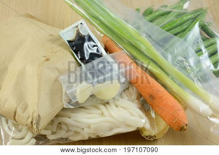 Packaged food items in meal delivery kit