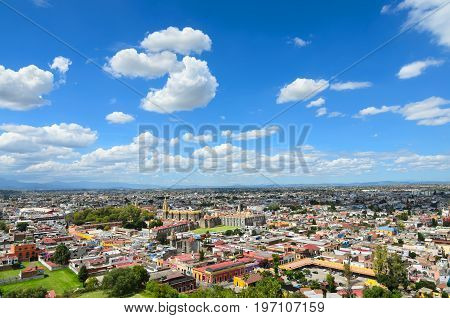 CHOLULA MEXICO 16 OCTOBER 2015: Aerial view to downtown of Cholula town under cloudy sky