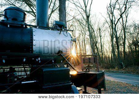 Antique Train in Railway Yard on a bright sunny day in model railway yard