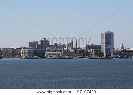 Buildings of city skyline across harbor in Charleston, South Carolina