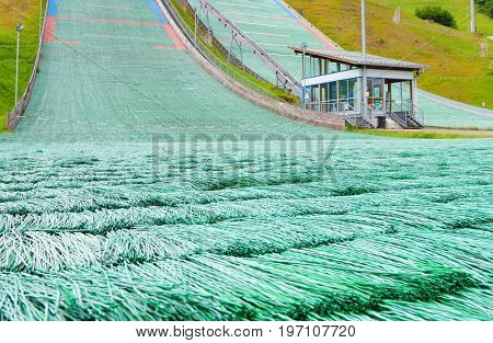 A dry ski slope or artificial ski slope closeup. This a ski slope mimics the attributes of snow using materials that are stable at room temperature.