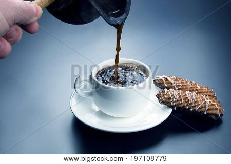 freshly brewed black coffee from the turks poured in a white Cup