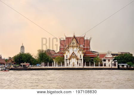 embankment with the view to beautiful Buddhist temple