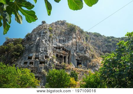 Fethiye rock tombs - 4th BC tombs carved in steep cliff. City of Fethiye, Turkey.