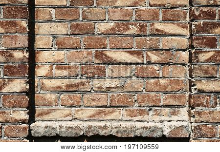 old brick wall for texture or background, dark red color, architectural elements as a brick filled frame