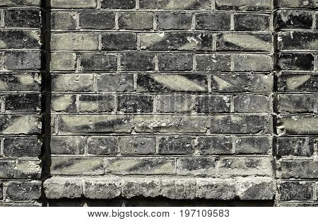 old brick wall for texture or background, dark color, architectural elements as a brick filled frame
