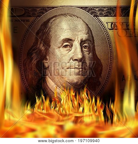 Conceptual image of burning dollar bill and fire flames